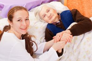 Caregiver comforting a senior