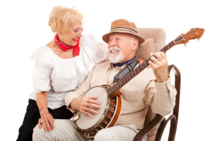 Happy senior playing a musical instrument